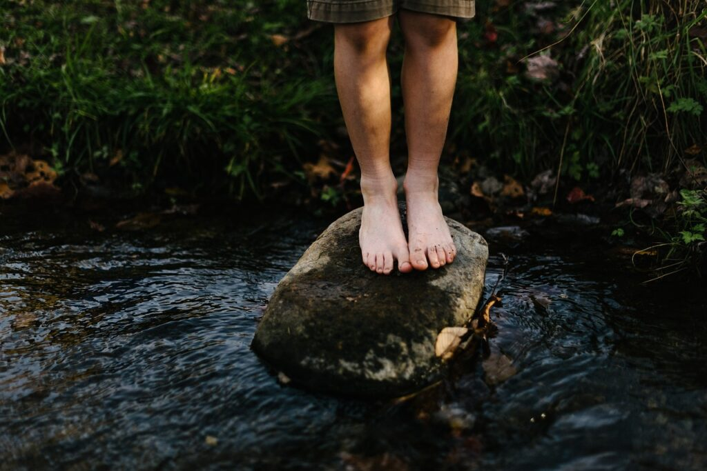 standing on a rock | Balanced Bodycare