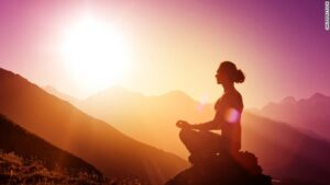 woman meditation on mountain | Balanced Bodycare